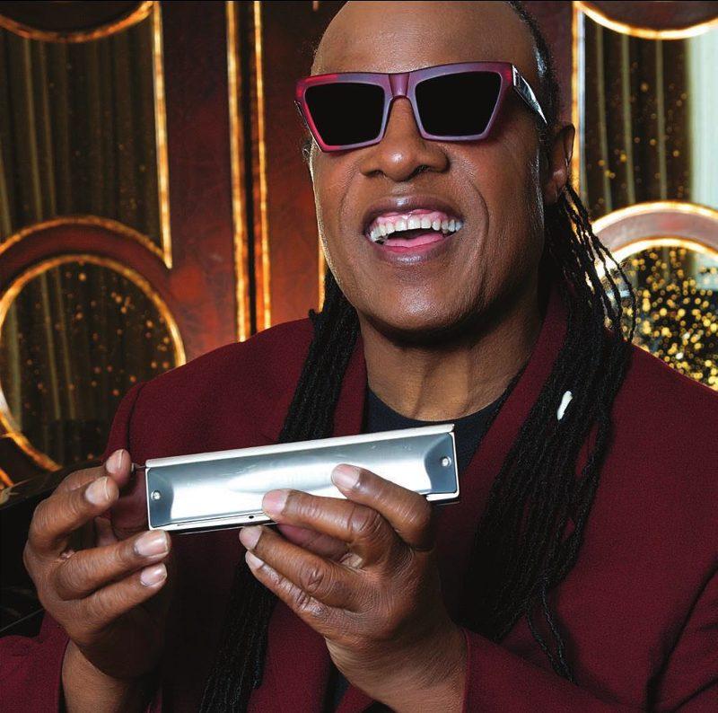 Stevie holding harmonica ready to play