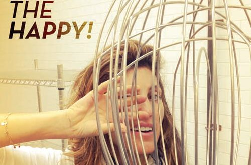 Celiac: Jennifer Esposito Peeks between the wires of a huge wisk in her kitchen.