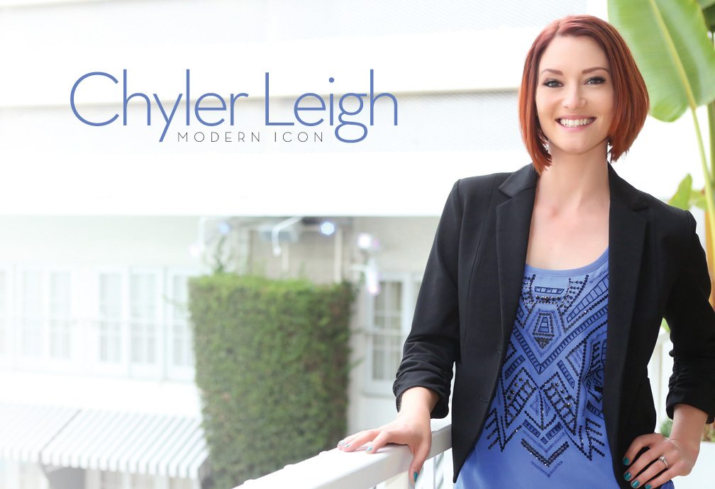 Chyler Leigh, Modern Icon. Image of Chyler Leigh standing on a balcony with hand on railing, smiling