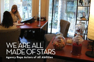 We are all made of stars. Talent agency for actors with disabilities. Image. Gail Williamson sitting behind her desk, talking to a client on the phone