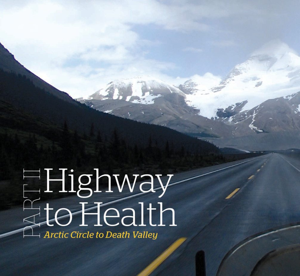 Title: Highway to Health Part 2. Image of road from a motorcycle on a winding road leading to a brown mountain with white snow-capped peaks