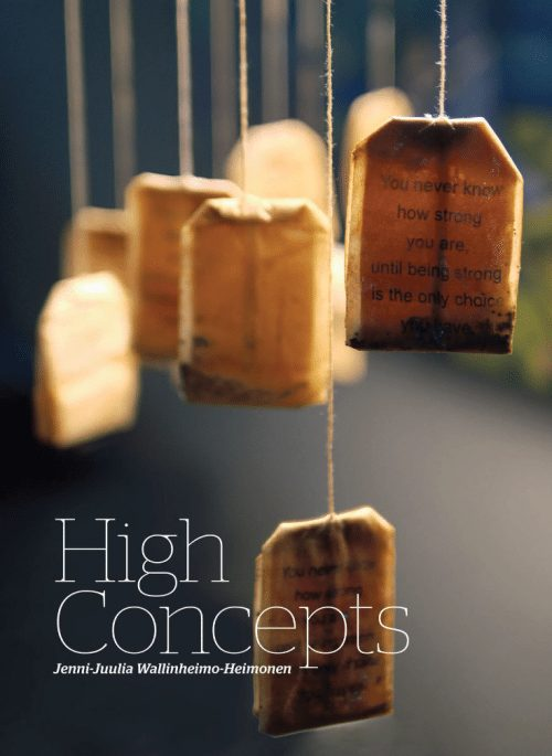 """Title: High Concepts. Image: Tan tea bag hang from strings, imprinted with message """"You never know how strong you are until being strong is the only choice you have""""."""