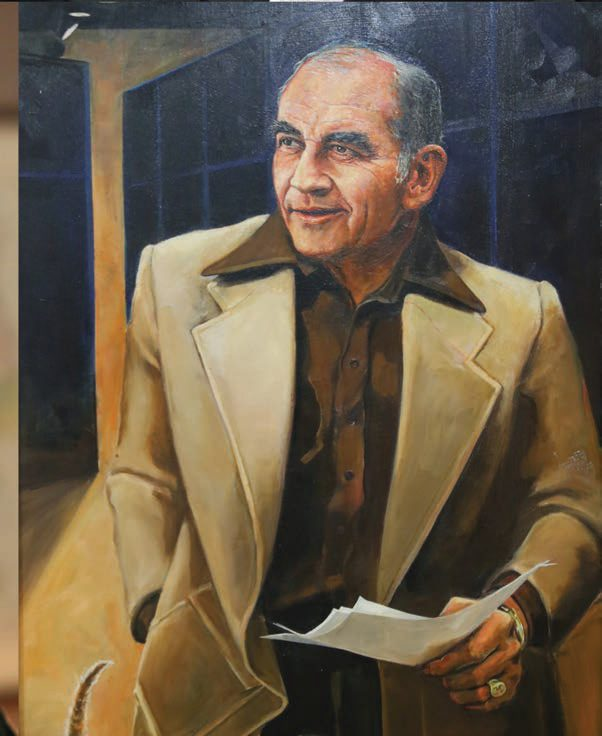 Oil portrait of Ed Asner on the set of a TV show holding a script in his classic 1970's style suit.