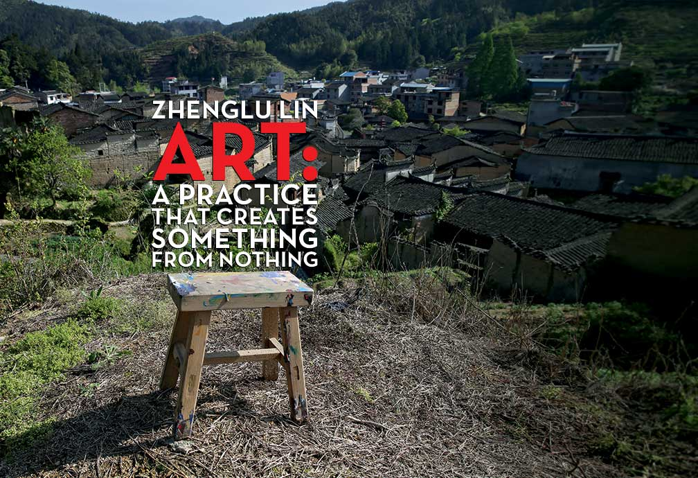 Title: Zhenglu Lin Art-A Practice of creating something from nothing. Image a four legged stool spattered with paing sits atop a hillside overlooking a village..