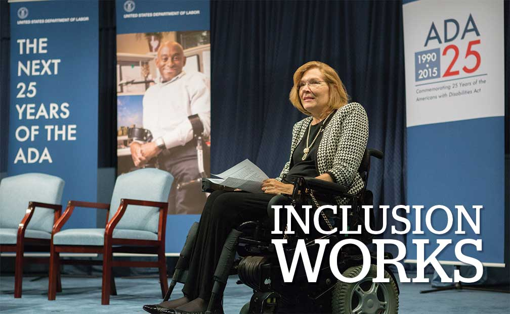 Title: Inclusion Works. Image: DAS Jennifer Sheehy presents on stage at the 25th anniversary of the ADA Celebration.