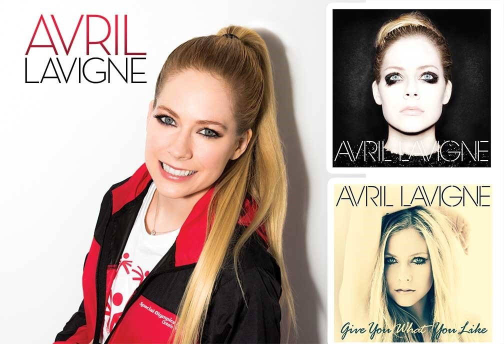 Avril Lavigne smiles with a red and black Special Olympics jacket.