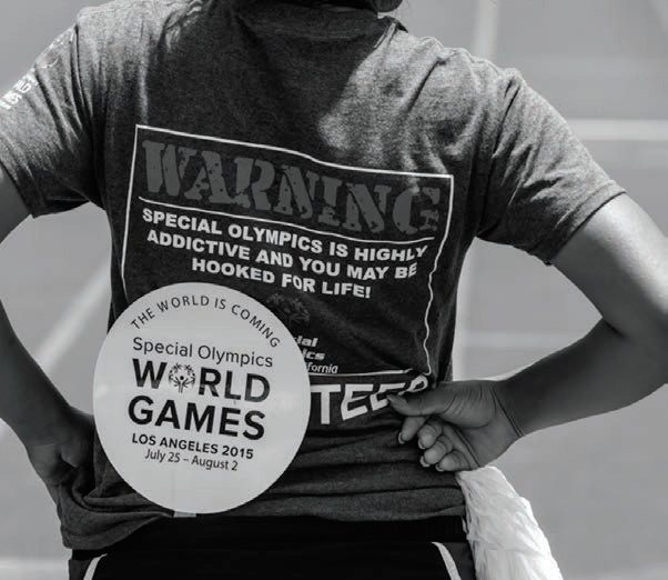 Young lady with Special Olympics t-shirt that reads: Warning: Special Olympics is highly addictive and you may be hooked for life.