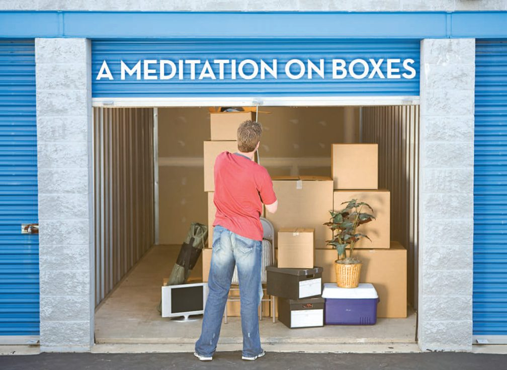 Title: A Meditation on Boxes. Image Man pulls down the sliding door of a storage unit full of boxes.