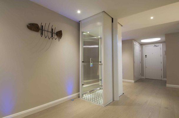 Stiltz glass enclosed wheelchair lift in a home setting