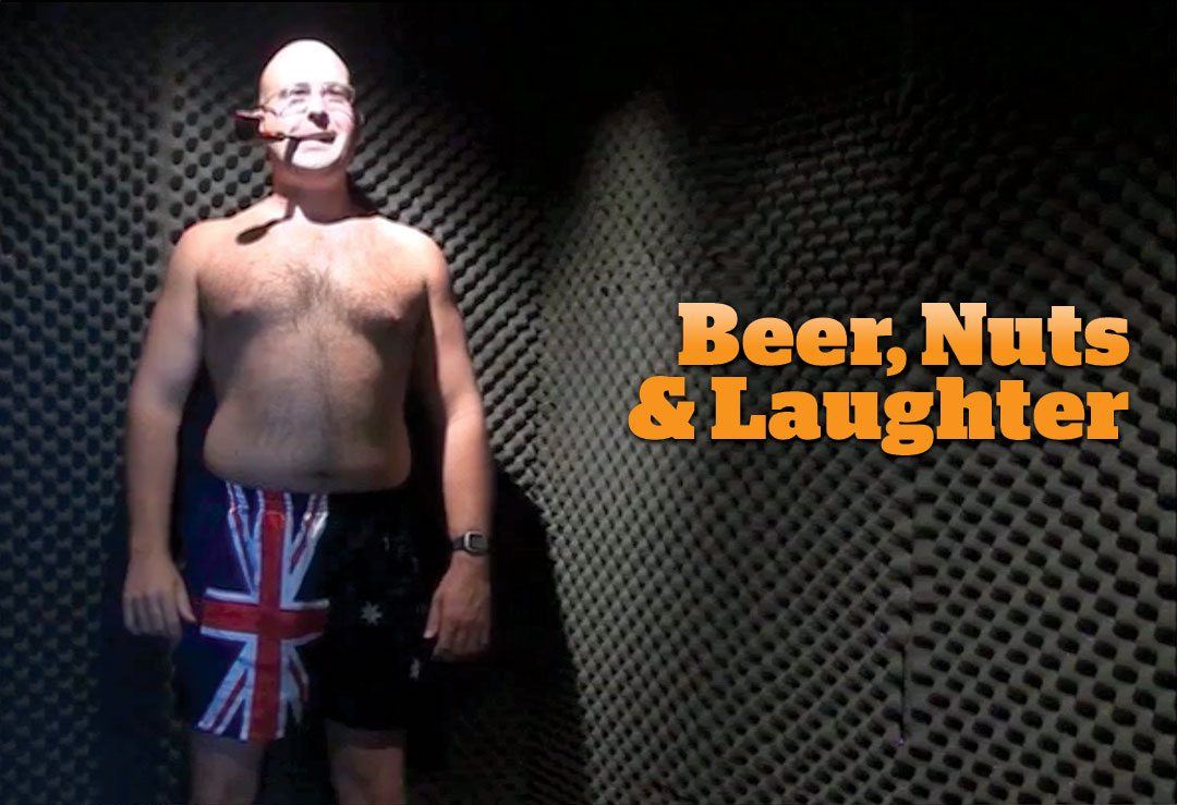 Beer, Nuts and Laughter--Image: With pipe in mouth and wearing Austrailian swimtrunks gough stands in the corner of walls with gray egg crate padding