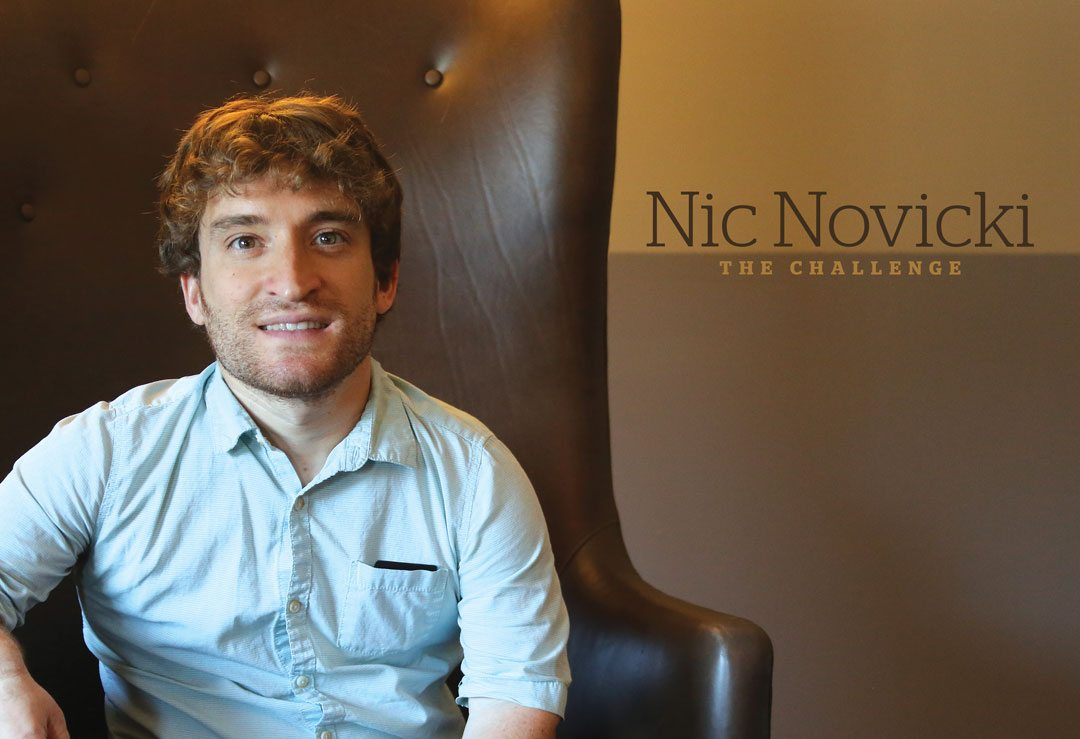 Nic Novicki, The Challenge. Novicki looks forward smiling, sitting in a leather arm chair.
