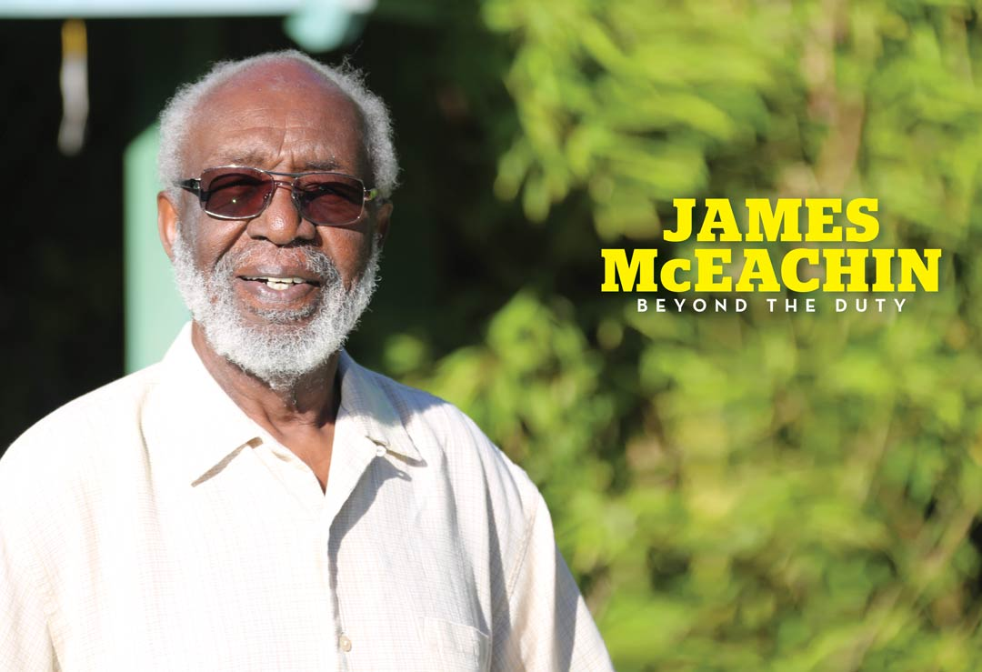 James McEachin on a sunny day with trees in background
