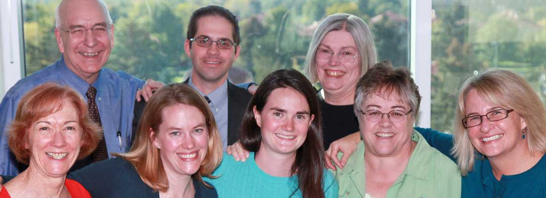 Front row, L to R: Pat Winders; Kristin Jensen, MD; Laura Seewald; Patti McVay, MS; Carolyn Doyle. Back row: Ed McCabe, MD, PhD; Anthony Airhart; Linda McCabe, PhD.