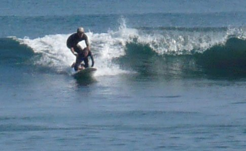 John C McGniley surfing with Max