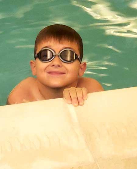 Max Blake swimming
