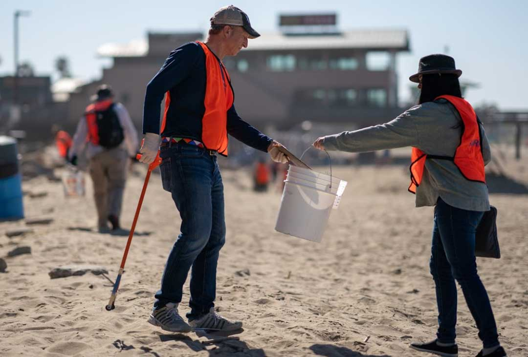 Tom Steyer cleaning up the beach