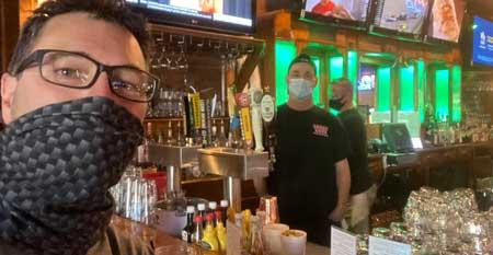Long Haul Paul social distancing at bar