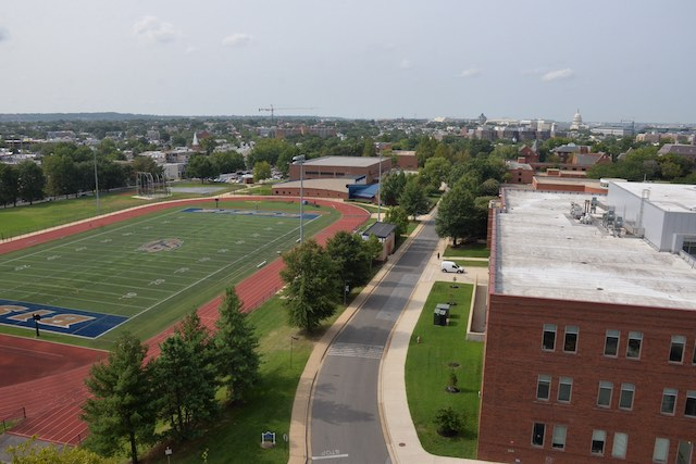 Gallaudet from above with a large red building and the football field behind it
