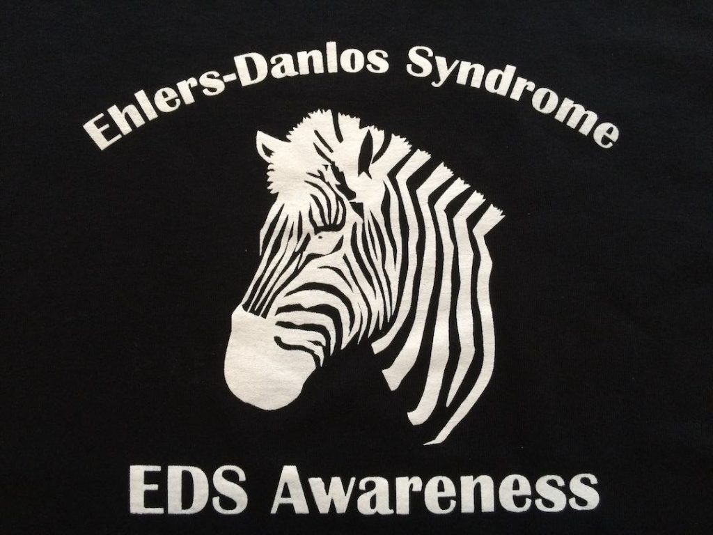 A shirt print: Ehlers-Danlos Syndrome - EDS Awareness